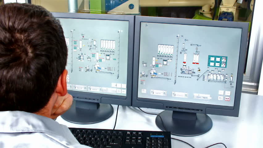 factory dashboard ; worker's computer controls the operation of machinery in the factory,video clip