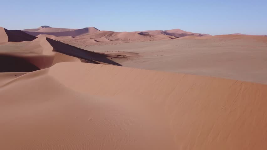 4K high quality aerial video scenic drone view of famous endless sand sea and Sossusvlei Namib Desert red sand dunes on sunny morning in Namib-Naulkuft Park in Namibia, southern Africa   Shutterstock HD Video #33735976