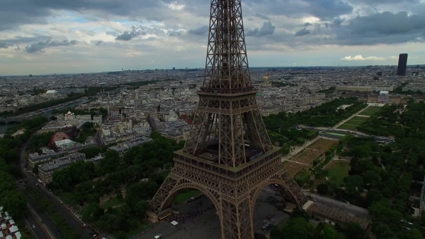 Beautiful aerial drone shot of Eiffel Tower, national symbol Paris France Champ de Mars steel monument cloudy cityscape