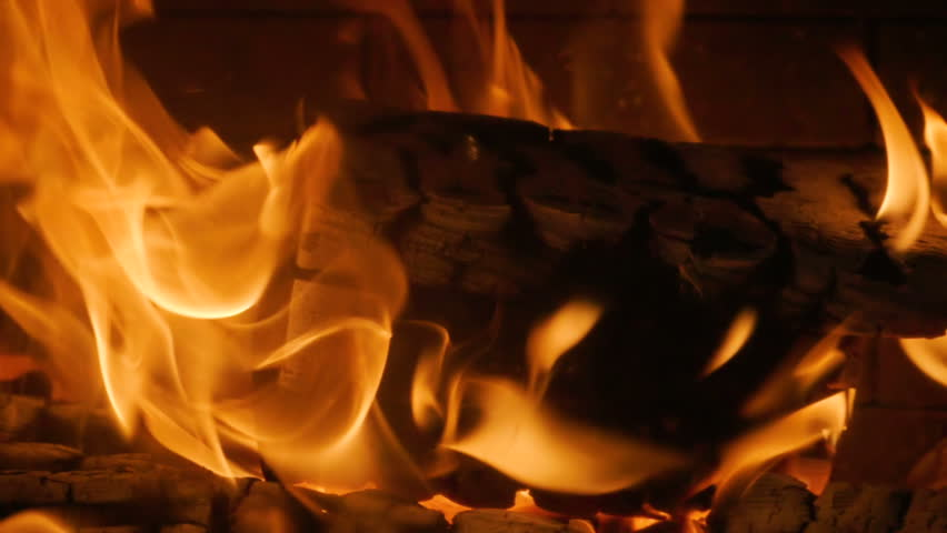 Close-up shot of warm cozy burning fire in a brick fireplace. Slow motion. HD | Shutterstock HD Video #33799489