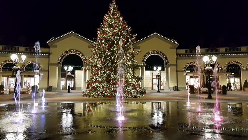 085c953015eb SERRAVALLE SCRIVIA, ITALY DECEMBER 5 2017, Beautiful & Colorful water  fountain show in the night with christmas tree in outlet shopping center  near milan ...