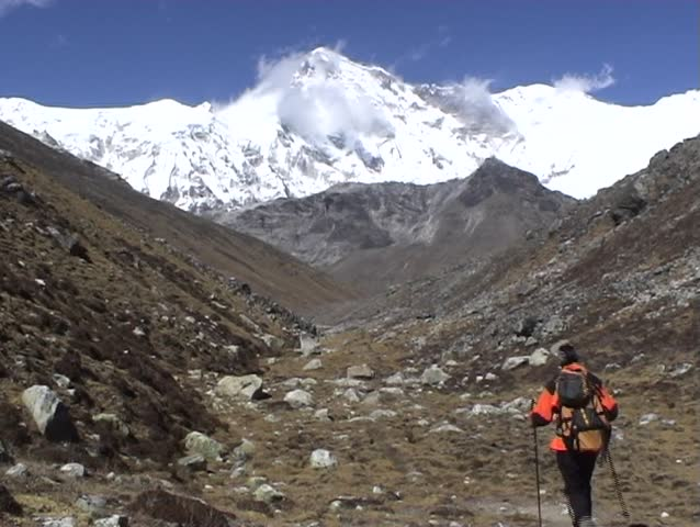 Trekkers below Cho Oyu Mountain, Everest region, Nepal