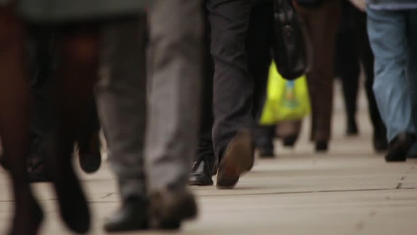 Time lapse of people's feet walking on the London Bridge