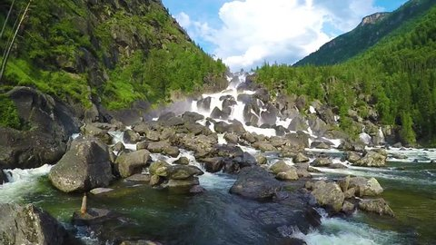 Waterfall Uchar. The height of the dam is about 300-350 m. The height of the water fall is about 160 m. Altai mountains, Siberia Russia. Slow motion.