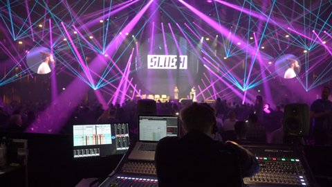 HELSINKI, FINLAND - NOVEMBER 30, 2017: Director of show manages sound and light with mixing console. Startup and tech show Slush Non-profit event for entrepreneurs, investors, students.