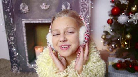 Girl in headphones listening music. Chirstmas