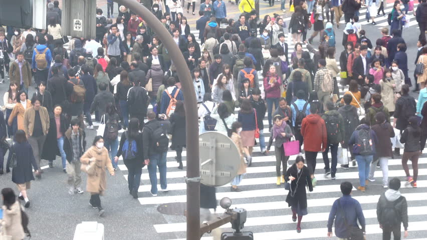 Shibuya, Tokyo, Japan - April 2, 2017: HD b-roll cinematic footage of Shibuya Crossing, one of the busiest road intersection in the world (scramble crosswalk). Zoom out #33885859