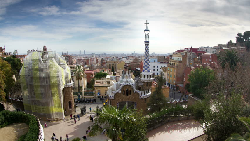 BARCELONA - JANUARY 07: A timelapse shot in Parc Guell, one of the city's major tourist attractions, with the urban skyline in the background, Barcelona, Spain. JANUARY 07, 2013.  | Shutterstock HD Video #3389009