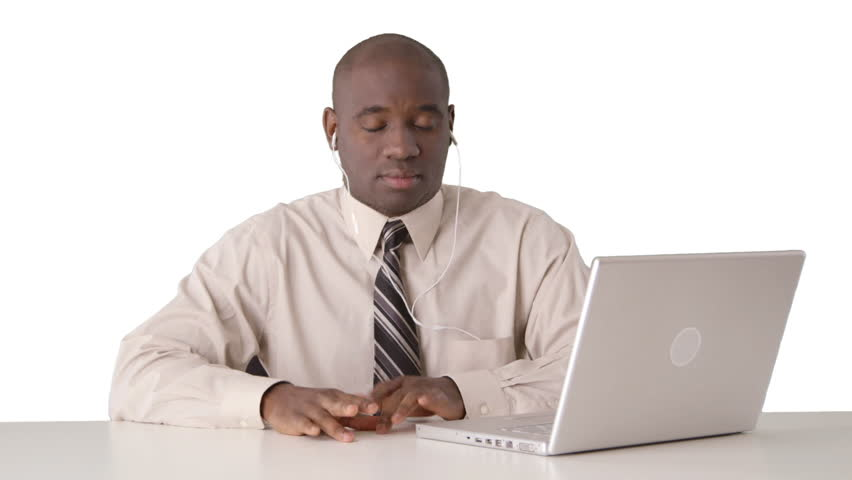 African American Businessman caught secretly listening to music at desk | Shutterstock HD Video #3389399