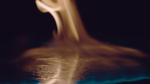 Ignition of gasoline with an electric lighter. The blue wave of fire moves to the camera. Macro. Closeup. S-log - High Dynamic Range. Slow mo, slo mo, slow motion, high speed camera, 240fps, 250fps