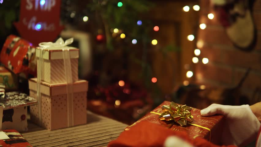 Santa Claus Places Presents Under The Tree At Night, Father Christmas, Eve