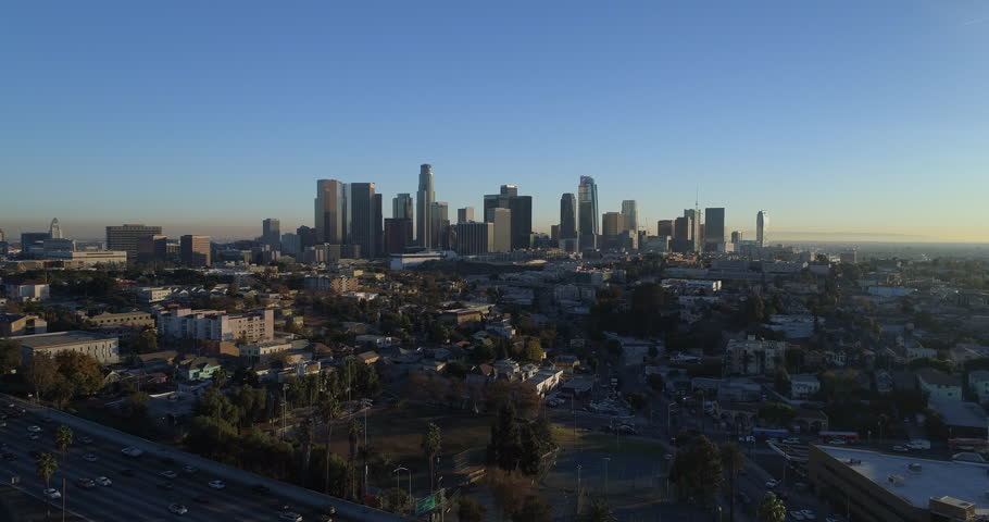 Cinematic aerial drone footage of urban downtown Los Angeles as seen from Echo Park with the city skyline, sky scrapers, freeway and traffic below. | Shutterstock HD Video #34029889