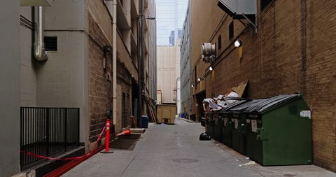 A daytime overcast static background plate of an alley in a large city's downtown district. Day/night matching available.