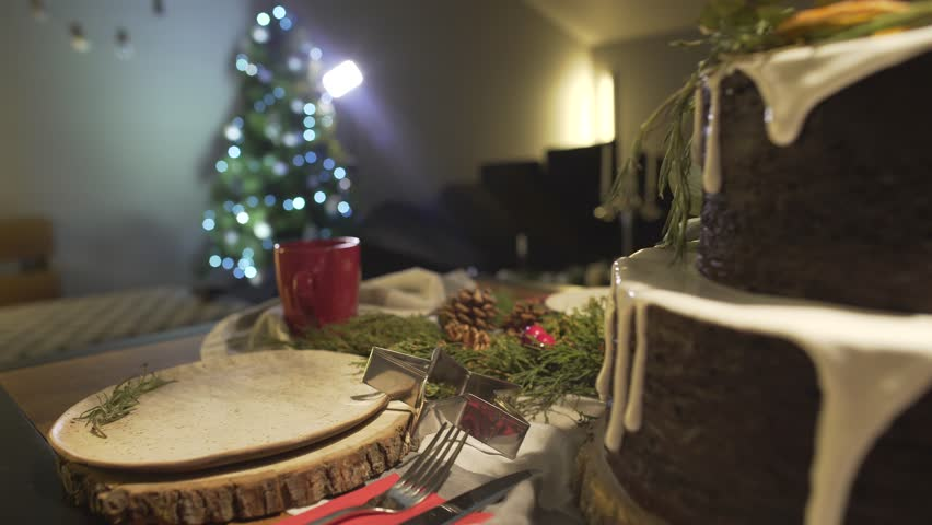 Close up view on delicious gingerbread cake on decorated Christmas dinner table in festive New Year Eve Noel atmosphere | Shutterstock HD Video #34059259