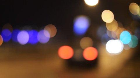 Bokeh car light at night. Out of focus traffic lights.