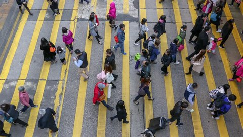 Busy pedestrian and car crossing at Hong Kong - time lapse