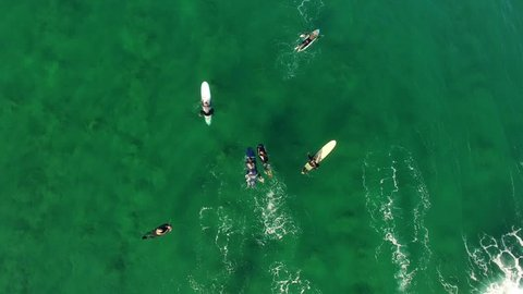 Group of surfers waiting for waves near ocean beach, Aerial view