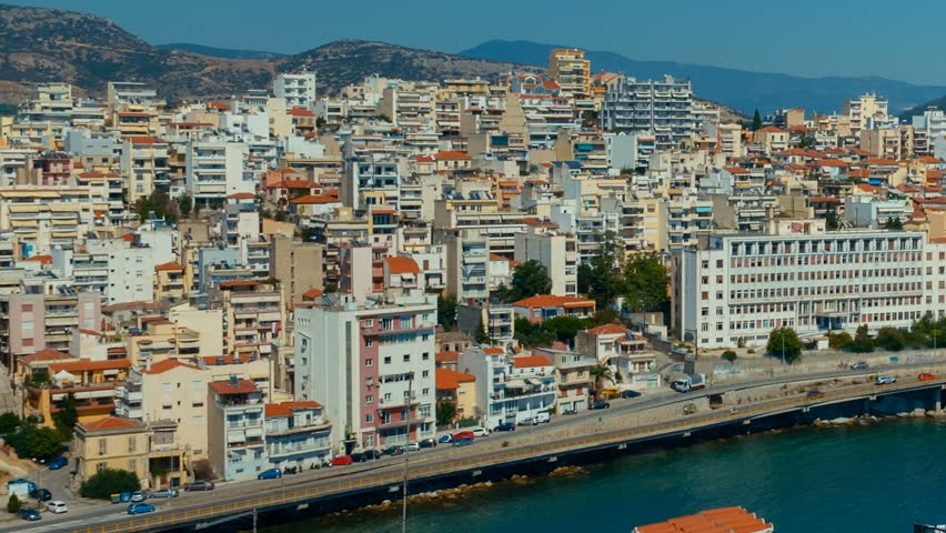 Telephoto establishing shot of the city of Kavala in Greece. Kavala is the main seaport of eastern Macedonia