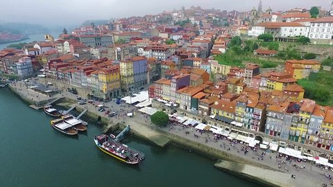 Panoramic view of the old city of Porto. One flew over the roofs of the houses, a river and a bridge.