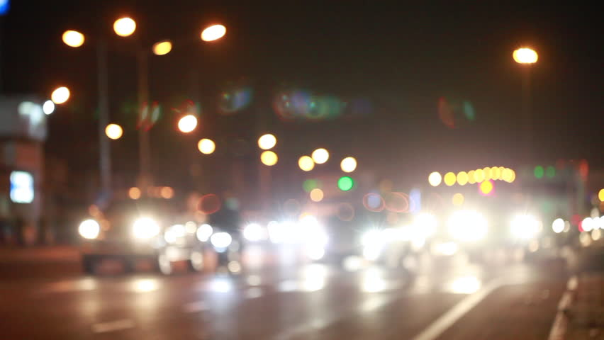 Car traffic at night at the intersection of busy cars Or bokeh from the car's ,lights Night travel concept for safety | Shutterstock HD Video #34154389