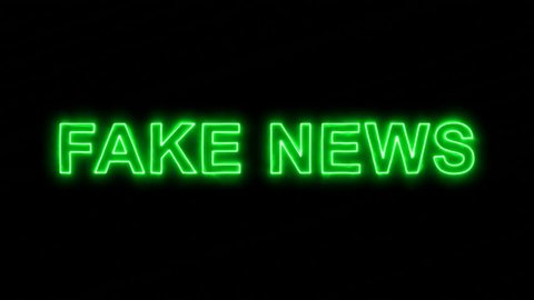 Neon flickering green common expression FAKE NEWS in the haze. Alpha channel Premultiplied - Matted with color black