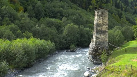 Watch medieval tower on the riverbank. Svaneti. Georgia. Medieval tower built for defensive purposes. Each family had its own tower.