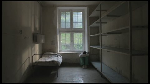 Ominous dolly shot of a patient in his hospital room