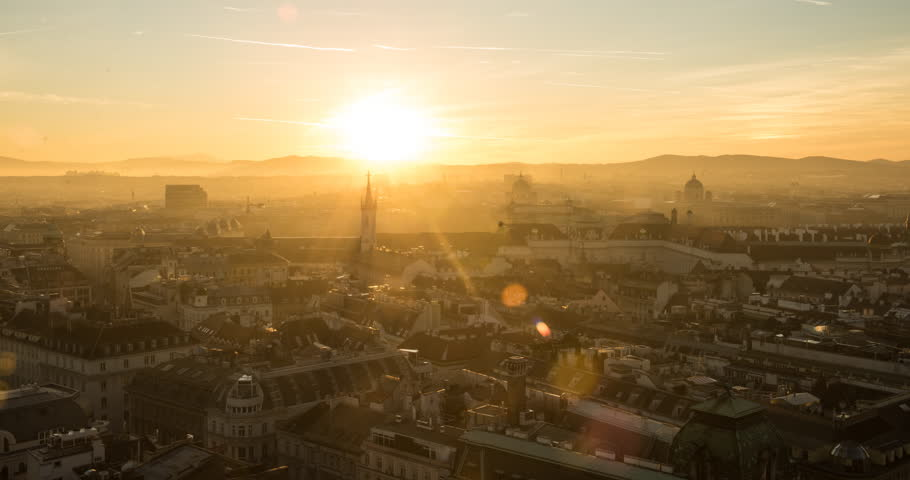 VIENNA, AUSTRIA – DECEMBER 2015 : Timelapse over central Vienna from St Stephens Cathedral at sunset with light changing and cityscape in view