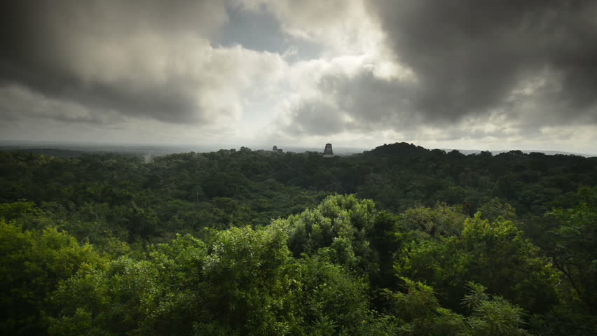 Clouds sweep over the major pyramids of Tikal National Park, time lapse #3423749