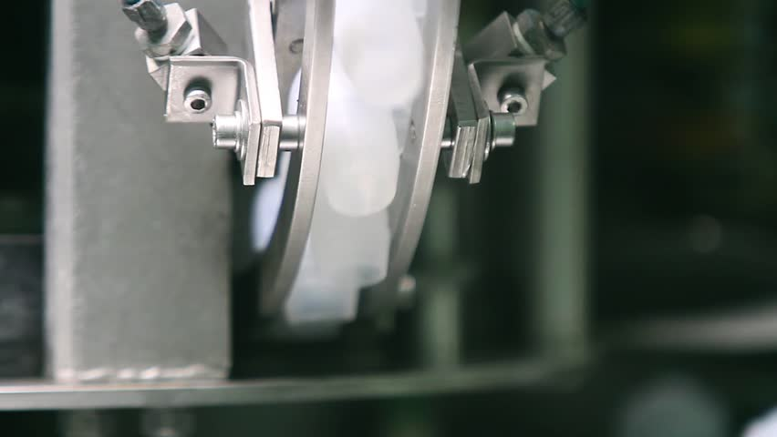 Sealing of champagne with a stopper at a factory of sparkling wines. Conveyor in the factory of champagne. Bottle of champagne at factory. Ambient sound at clip. | Shutterstock HD Video #34243849