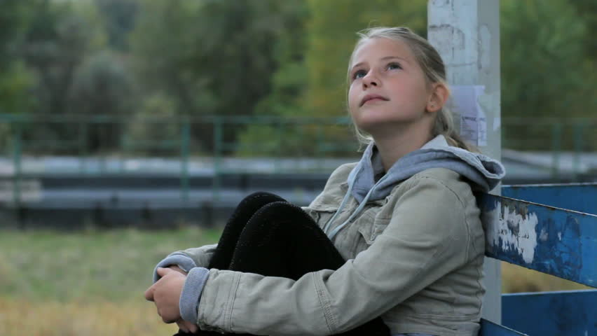 Pensive And Bored Little Girl Sitting Outdoor Alone, Loneliness, Child, Kids Stock Footage -2817