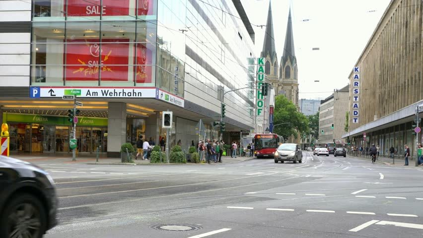 Dusseldorf, Germany - August 4,2017: Crossroads of  streets of Schadow Strasse, Jacobi Strasse, Wehrhahn Strasse and Tonhallen Strasse in city center with St. Maria Empfaengnis church on backgraund