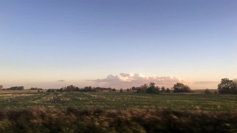 Rural landscape in the argentinian pampas as seen from a moving car