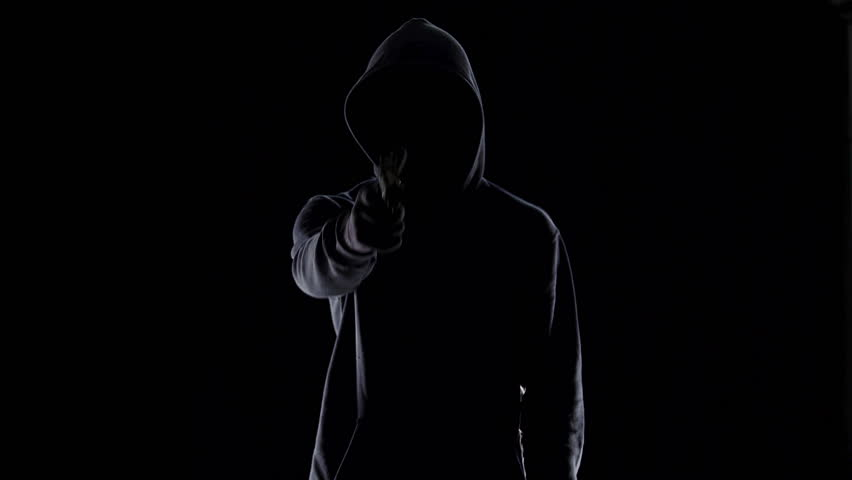 Silhouette of male contract killer shooting victim with gun, committing crime