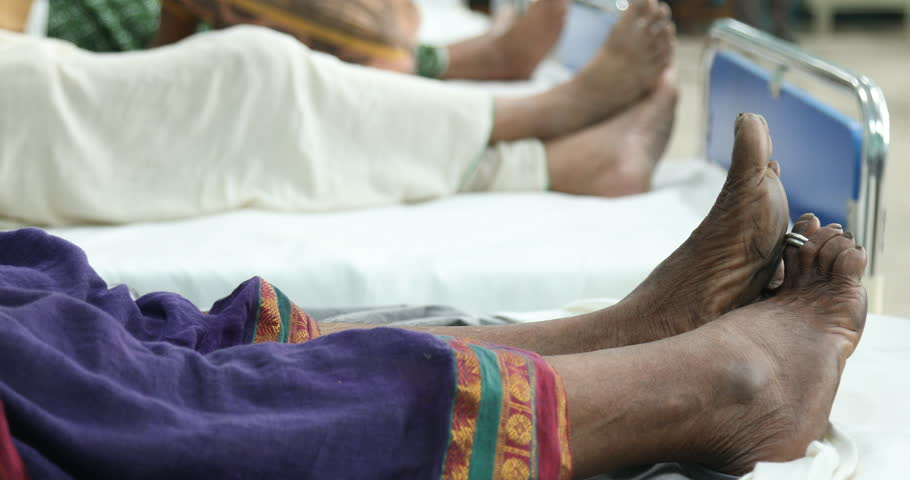 Old women Foot on hospital bed