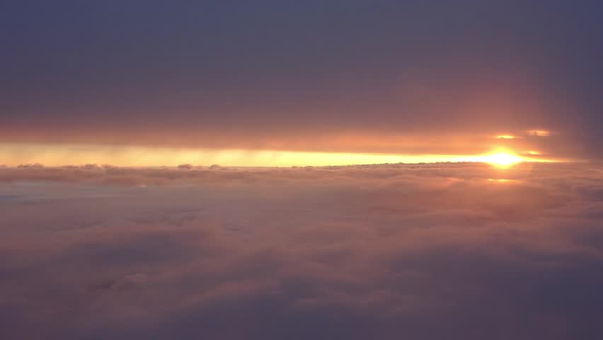 Fantastic sunrise within the clouds, shoot from the airplane window