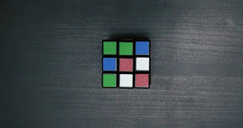 collecting a colorful puzzle cube close up