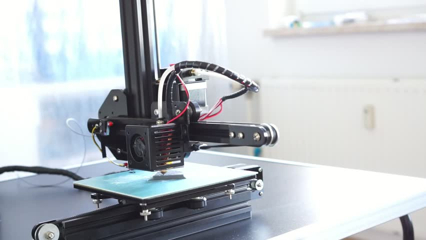 Small home 3D printer prints plastic toy  filament | Shutterstock HD Video #34416409