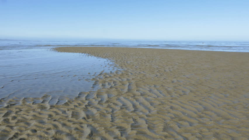Time lapse of incoming tide, sea water level rising, taking over the beach, waves covering the golden sand, rib pattern stretching out, South Island coast, New Zealand | Shutterstock HD Video #34444549