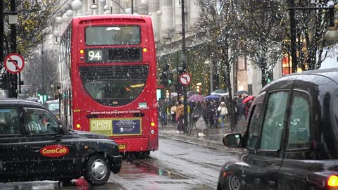 London,UK - 12-09-17: Routemaster is the one of Transportation in London. Red Bus and Black Cab in snow day at central London around Oxford street.