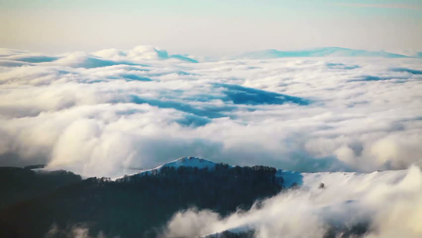 Floating clouds over the mountain tops