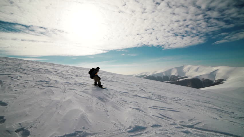 Snowboarders come down from the mountain | Shutterstock HD Video #3448529