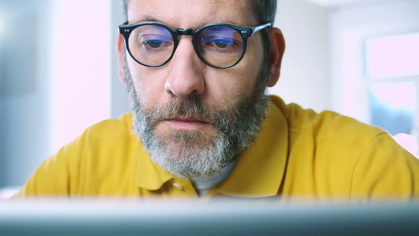 Businessman working at home office - close up tracking shot