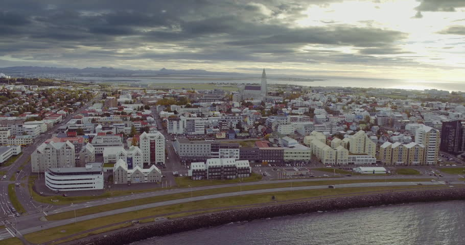 REYKJAVIK, ICELAND – SEPTEMBER 2016 : Aerial shot of central Reykjavik cityscape Hallgrim Church and ocean in view | Shutterstock HD Video #34503649