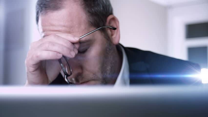 Businessman gets very bad news on his computer screen | Shutterstock HD Video #3451832