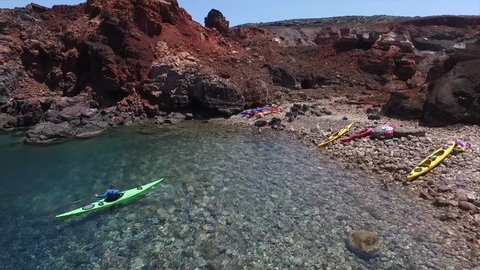 Summer holiday fun! Drone shot of a remote beach where  sea kayak leader practices rolls in warm Mediterranean waters. 1080p 60fps Authentic and epic!