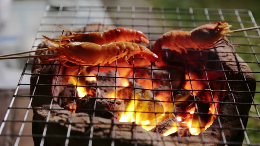 Prawns grilled on charcoal stove | Shutterstock HD Video #34532269