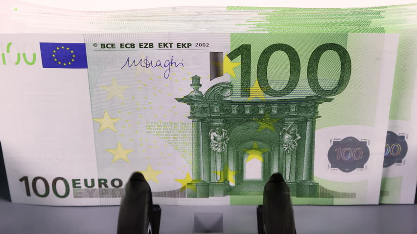 Overhead video shot of counting 100 euro banknotes on currency counter machine, close-up  | Shutterstock HD Video #34575949