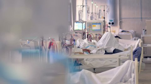 A medical ward with patients undergoing dialysis treatment.