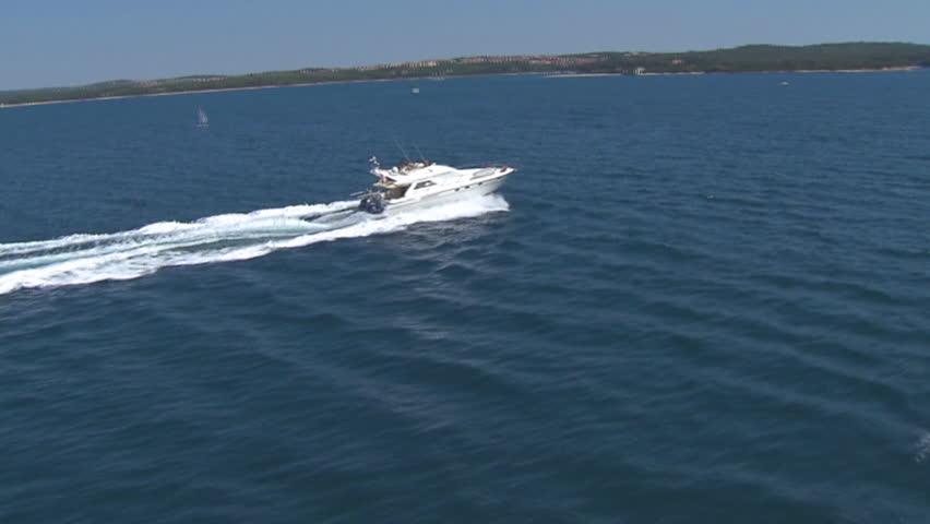 A speedboat speeds across Adriatic sea near Brijuni, Croatia